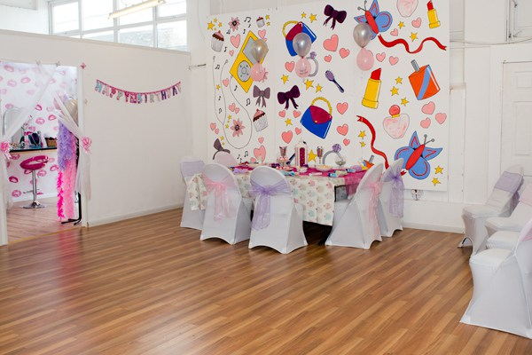 Photoshoot party pamper room in the studio with party table set for a princess