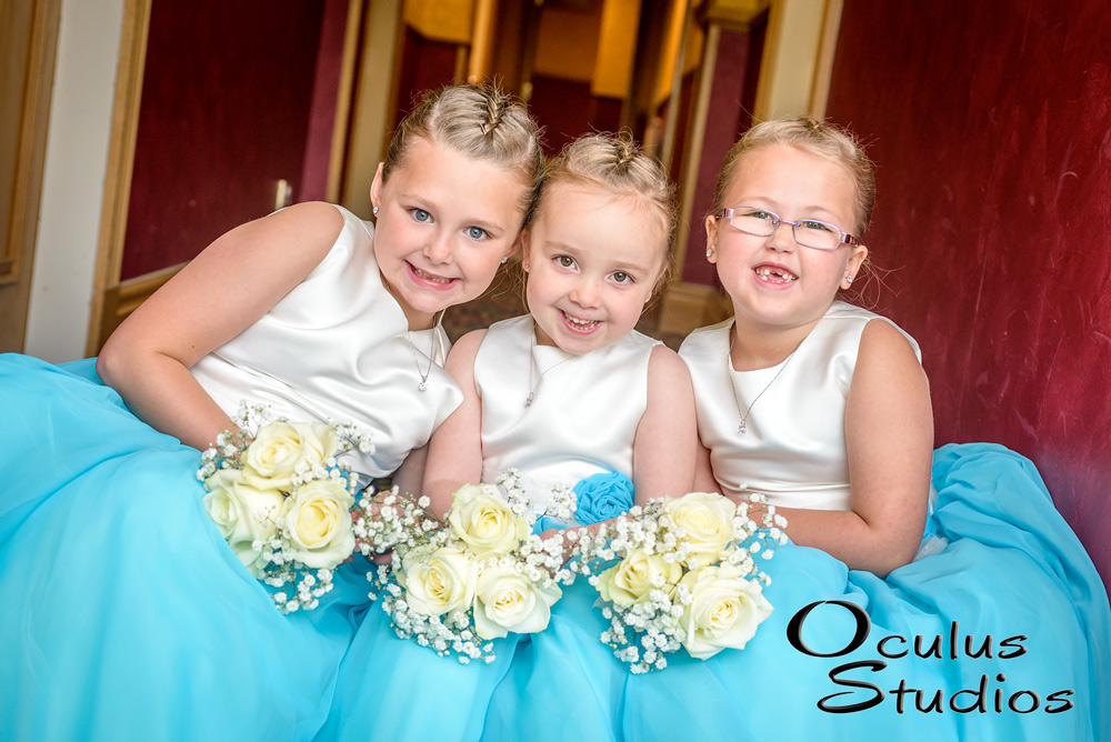 Three young Flower Girls smiling