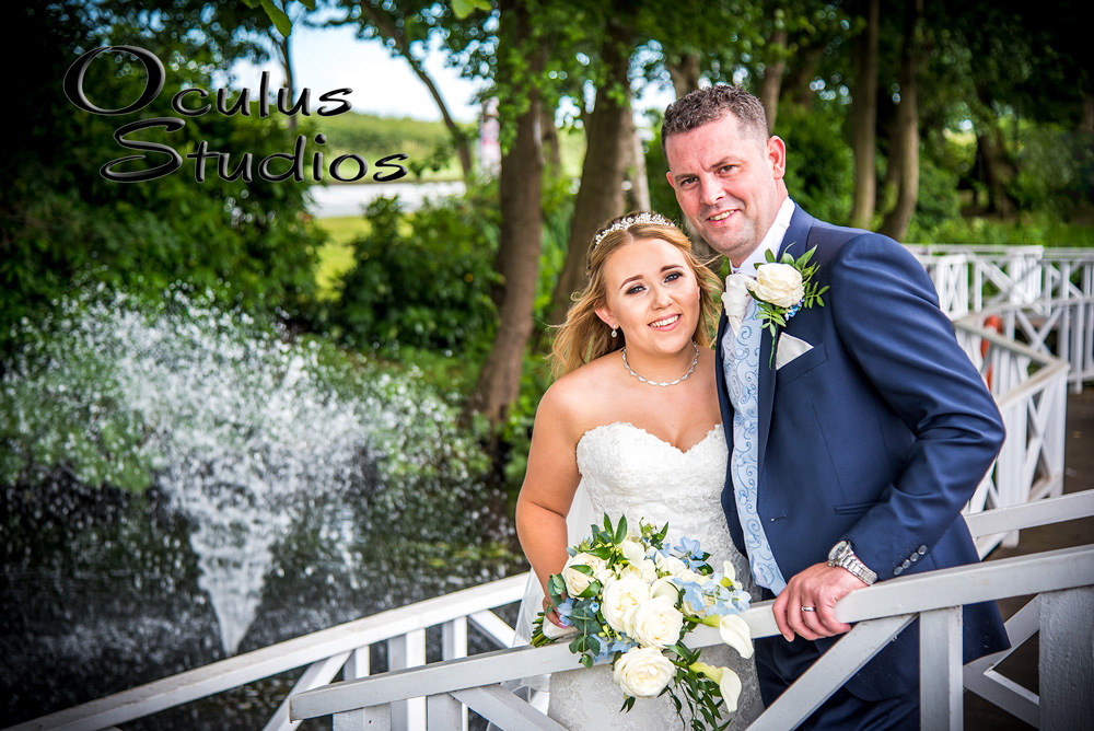Bride and Groom posing by a fountain - Wedding photographer Cheshire